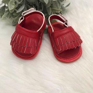 Adjustable fringe sandals